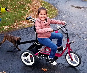 Tessa and her new bike.